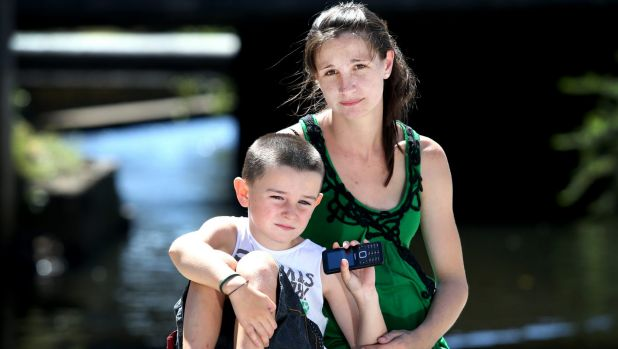 Dayna Alldridge and her son Tyler, six, whose phone has been receiving texts from random numbers requesting sexual favours.