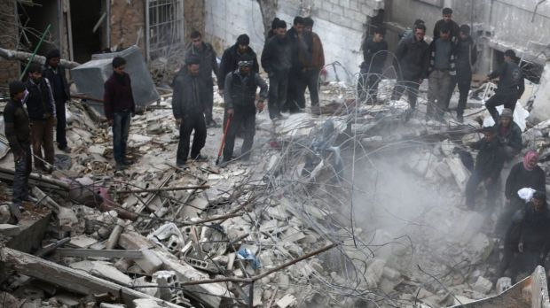Syrian civilians search for survivors at the site of reported air strikes in the rebel-held area of Douma, east of Damascus.