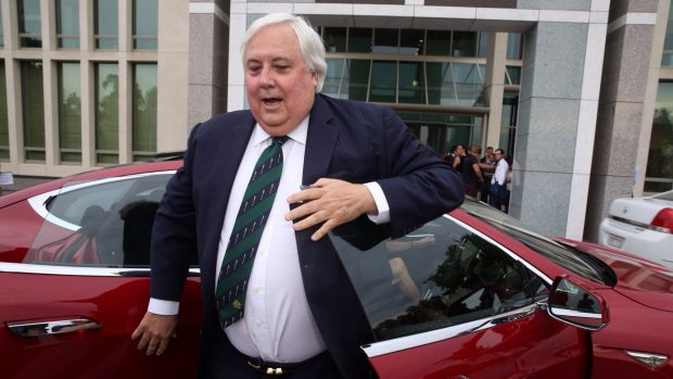Clive Palmer arrived at Parliament House on Thursday in a Tesla electric car.