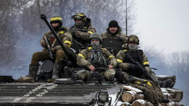 Members of the Ukrainian armed forces ride on an armoured personnel carrier (APC) near Debaltseve, eastern Ukraine, ...