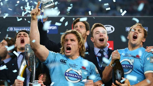 First wins first: Waratahs captain Michael Hooper celebrates with teammates after last year's victory.