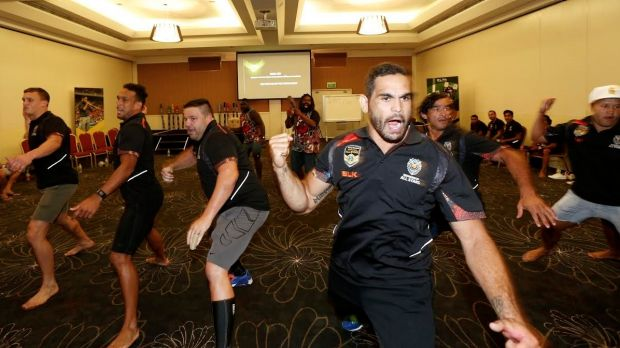 In step: Greg Inglis leads the Indigenous All Stars in a rehearsal of the warrior dance that will take place before the game.