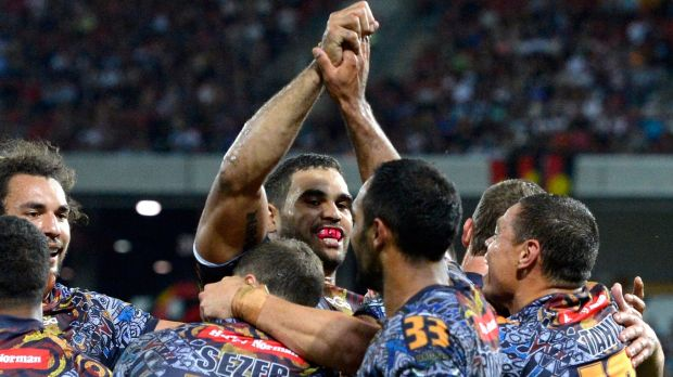 Proud people: Greg Inglis celebrates with Indigenous All Stars teammates in 2013.