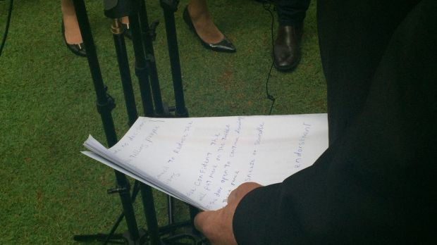 Katter's Australian Party MP Shane Knuth checks his notes before a media conference.
