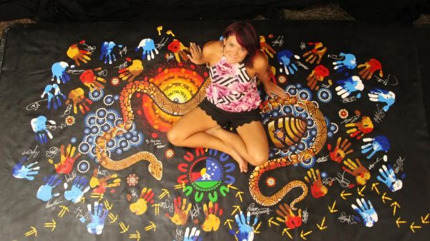 Chern'ee Sutton with one of her pieces for the  Indigenous All Star game. The piece will be auctioned off by the NRL to ...
