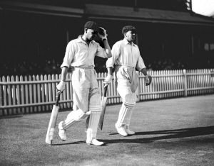 Bill Ponsford and Bill Woodfall walking on to the field. Date unknown.