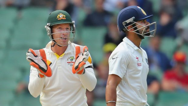 War of words: Brad Haddin and Virat Kohli  exchange words during the Third Test at the MCG.