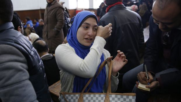 """Jehan Rashed, wife of Baher Mohamed, said """"I am going home immediately to tell the children, Dad is coming home""""."""