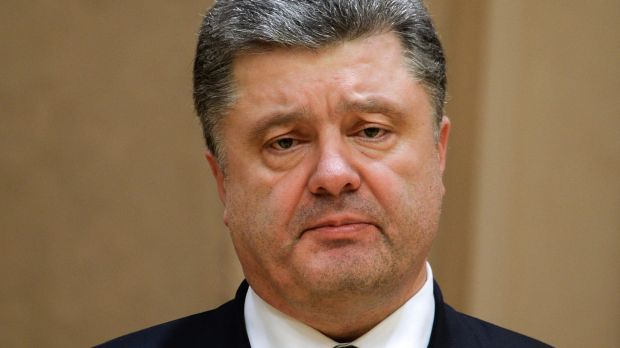 Ukrainian President Petro Poroshenko looks on during a press conference after a summit aimed at ending 10 months of ...