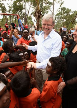 """Kevin Rudd, pictured at a school in the East Arnhem Land community of Yirrkala in 2008, has warned of new """"stolen ..."""