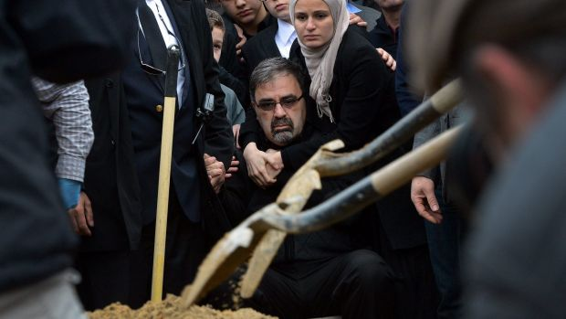 Namee Barakat sits during funeral services for his son,  Deah Shaddy Barakat.