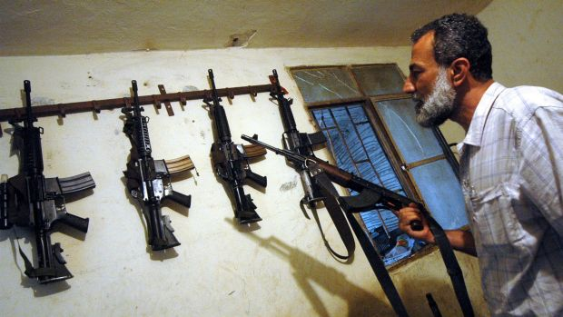 Fatah commander Munir al-Makdah with weapons at his home in Ain al-Hilweh.