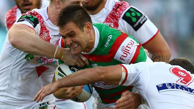 New colours: Tim Grant hits the ball up for the Rabbitohs during the Charity Shield match against the St George ...