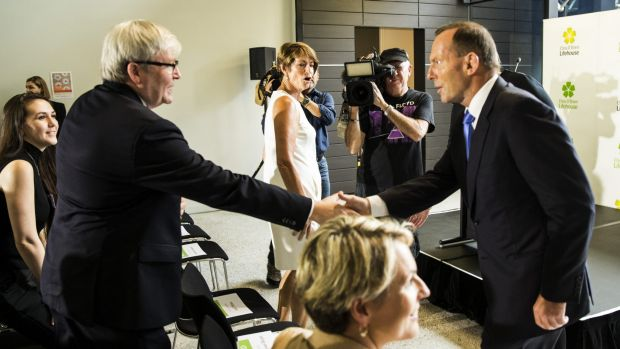 Here to help: Kevin Rudd greets Tony Abbott at the opening of the Chris O'Brien Lifehouse Hospital in Camperdown.