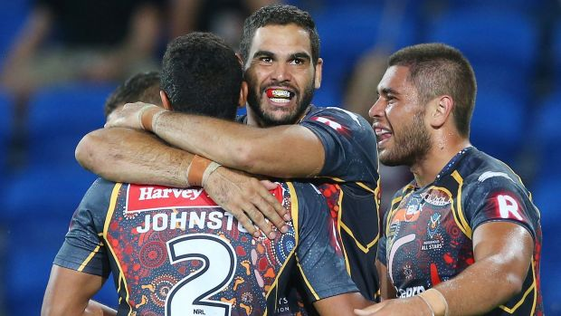 Band of brothers: Inglis celebrates a try .