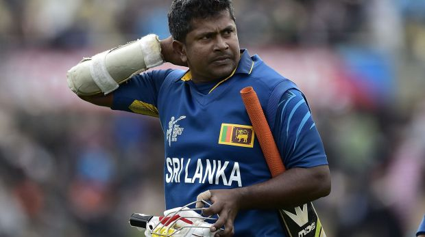 Rangana Herath walks from the field after being caught out, ending the Sri Lankan innings.