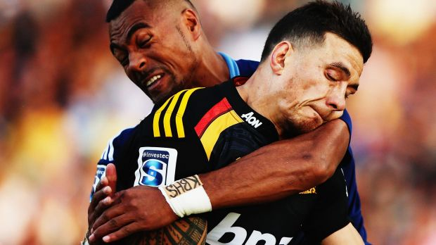Crunch time: Lolagi Visinia of the Blues tackles Sonny Bill Williams.
