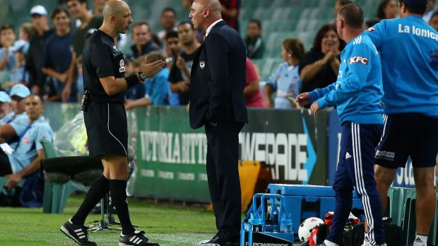 Flashpoint: Referee Strebre Dilovski speaks to Melbourne Victory coach Kevin Muscat on the sideline.
