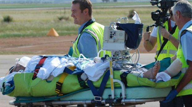 Sean Pollard is transferred to an aircraft to be flown to Perth after the shark attack.