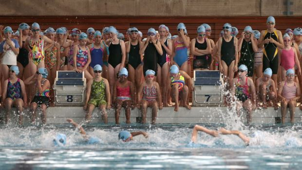 The competitors wait to hit the pool for the swim leg.