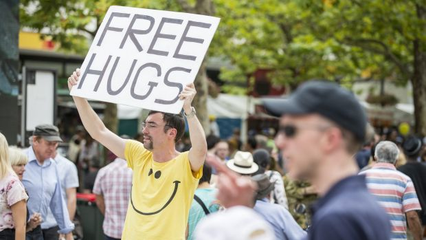 A man offers free hugs at the festival.