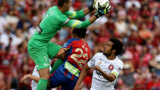 Keeper's ball: Ante Covic climbs high to claim the ball over Jets player Kije Lee.