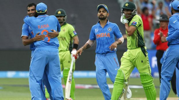 Mohammad Shami (L) celebrates with teammates after taking a wicket against Pakistan.