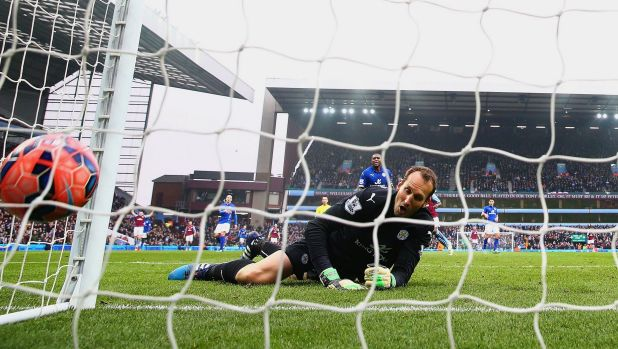 Leicester City's Mark Schwarzer watches a ball from Scott Sinclair hit the back of the net for Villa.