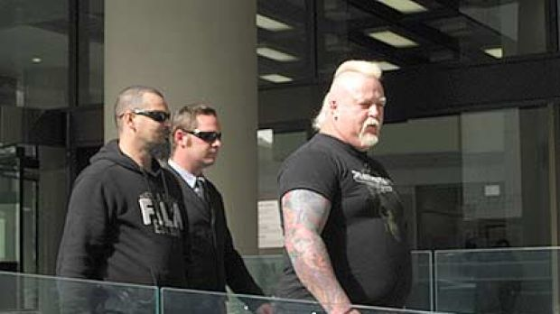 Bradley Neil Trappitt (middle) and his two burly minders in front of the Perth Magistrates Court.
