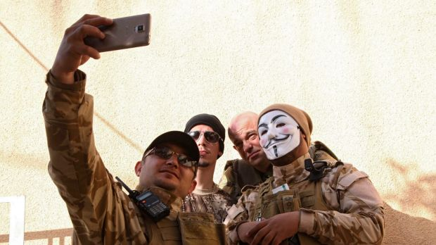 Westerners who have joined the Iraqi Christian militia Dwekh Nawsha to fight against Islamic State militants, take a ...