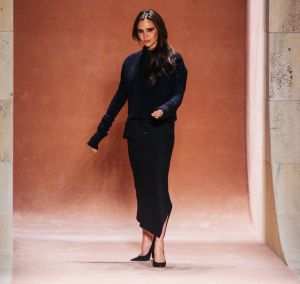 Taking a bow: Victoria Beckham makes a quick catwalk appearance after her latest show in New York.