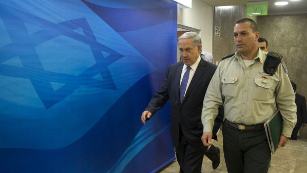 Israeli Prime Minister Benjamin Netanyahu arrives to chair the weekly cabinet meeting at his Jerusalem office on Sunday.