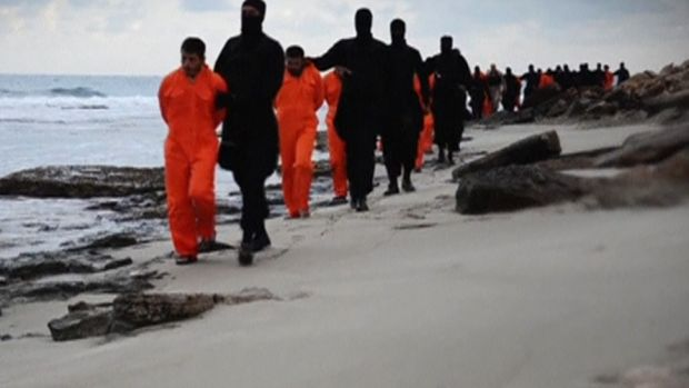 Men purported to be Egyptian Christians held captive by the Islamic State are marched by armed men in this still image ...