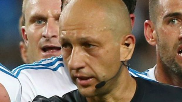 Ref drama: Melbourne Victory players argue with referee Strebre Delovski during the round 17 match against Sydney FC.