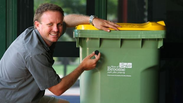 Shire of Broome waste coordinator Jeremy Hall with one of the radio frequency ID tags being placed on Broome bins.