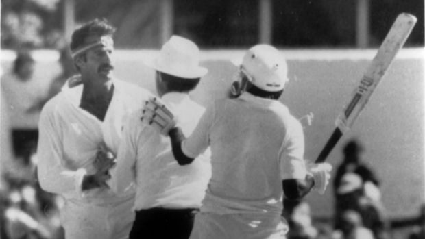 Not happy, Javed: Javed Miandad, right, attempts to get after the Pakistan team following their loss to India.