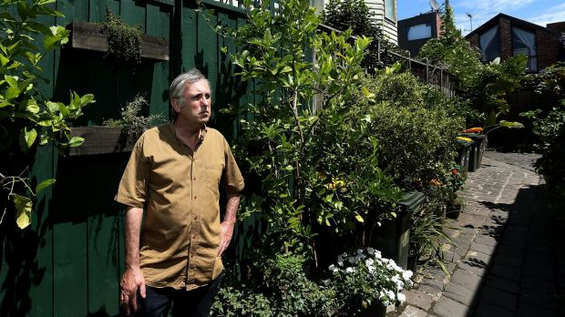 Greens councillor Sam Gaylard photographed in the controversial laneway garden.