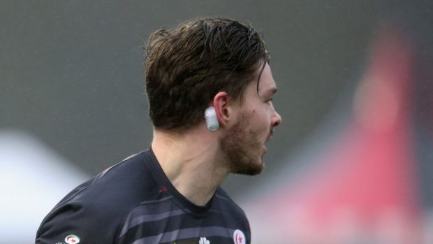 Ben Ransom of the Saracens rugby union club in England wears a impact sensor behind his ear to help determine the ...