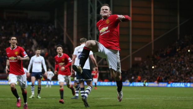 Manchester United's Wayne Rooney celebrates scoring their third goal with a penalty.