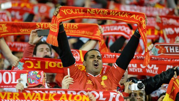 Liverpool supporters sing as they watch the match between Liverpool and the Melbourne Victory at the MCG in 2013.
