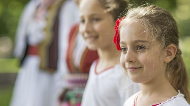 Lilly Nedeska, 6, and members of the Macedonian dance group in Queanbeyan