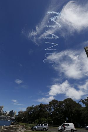 """Three artists used skywriters to get the """"Shut down Manus"""" message across."""