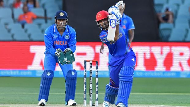 Afghanistan's Nawroz Mangal drives during a warm-up match against India in Adelaide.