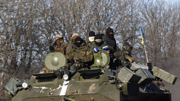 Ukrainian government soldiers on a road stretching away from the town of Artemivsk, Ukraine, towards Debaltseve.