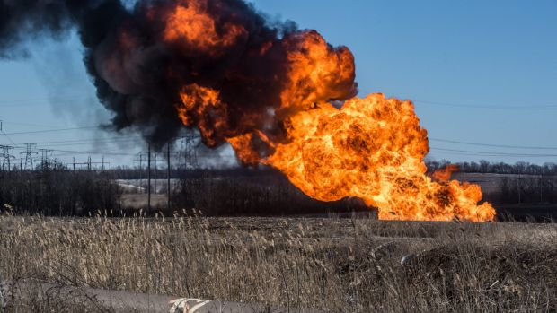 A gas pipe burns after being struck by shelling in Myronivskyi, Ukraine.