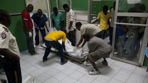 The body of a person killed during carnival celebrations is moved at the General Hospital in Port-au-Prince, Haiti, ...