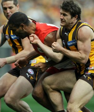 Hawthorn's Campbell Brown crunches Sydney's Michael O'Loughlin.