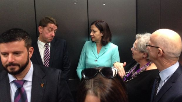 Queensland health minister Cameron Dick discussing health funding with premier Annastacia Palaszczuk in the lift at the ...