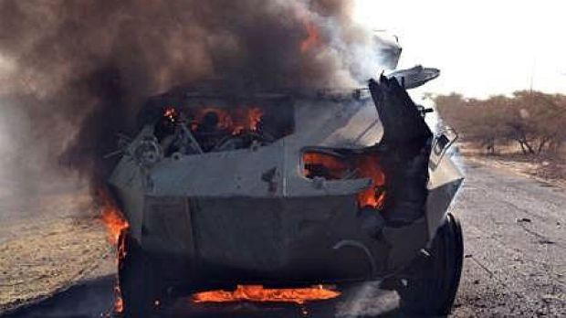 A Boko Haram armoured vehicle burns after being set ablaze by the Nigerian military at Monguno.
