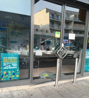 The front windows of the Optus store were smashed.